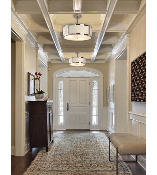 From a contemporary bathroom light atop an elegant mirror to a dramatic sconce illuminating a formal entryway justice design group designs and produces